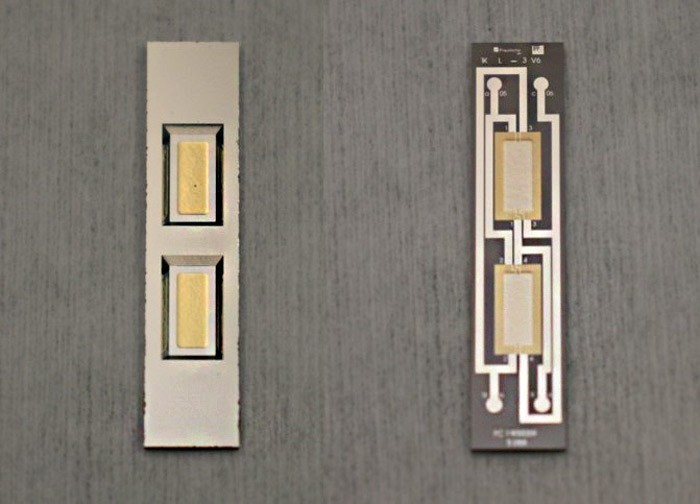 Two sides of a Fraunhofer-IMM single-channel supported-membrane sensor prototype (size 5 × 23 mm2). The two gold absorbers are deposited on silicon-nitride membranes with a silicon support around them. The other side has platinum tracks.