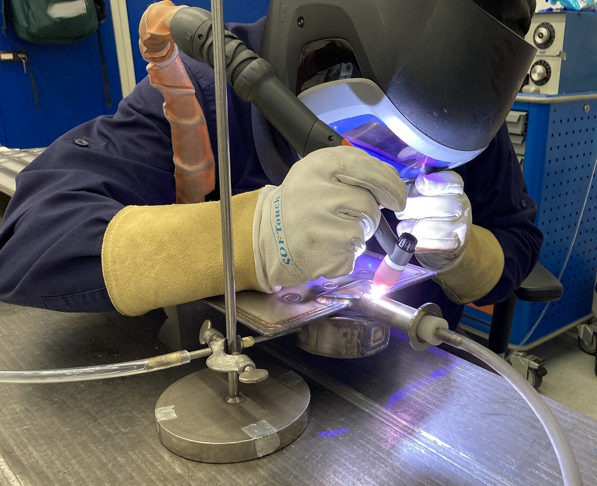 Welding the cryopanels at Research Instruments (RI), Germany.